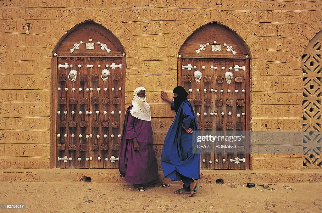 Two Tuareg men outside the doors of a building in Timbuktu Mali