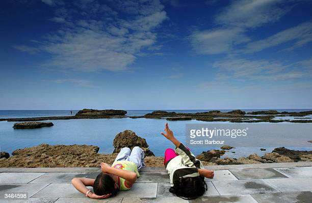 Two Turkish Cypriot children relax by the beach on April 24 2004 in Famagusta Cyprus More than threequarters of Greek Cypriots have voted against a...