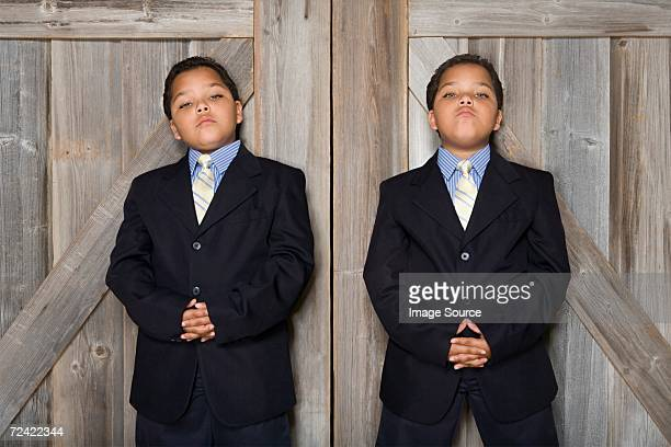 Two twin boys wearing suits