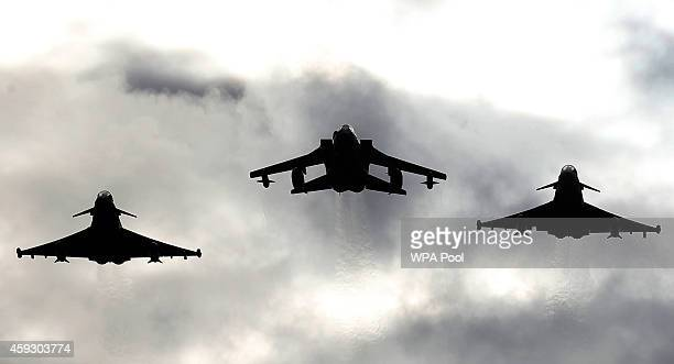 Two Typhoons and a Tornado jet fly past during a visit by Queen Elizabeth II to RAF Lossiemouth on her 67th wedding anniversary on November 20 2014...