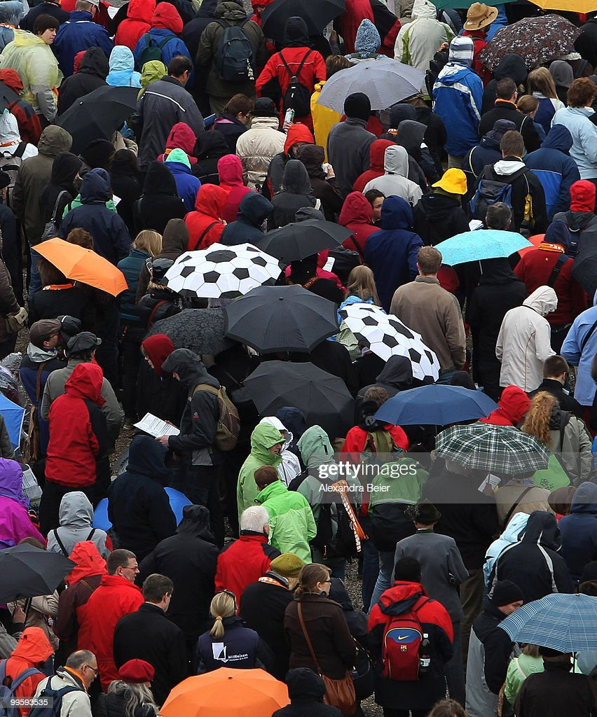 Two umbrellas looking like soccer balls are seen during the final holy mass at the last day of the 2nd Ecumenical Church Day (2. Oekumenischer Kirchentag) on May 16, 2010 in Munich, Germany. Thousands travelled to the southern German city to take part in the Church Day events held from May 12 to May 16, 2010.