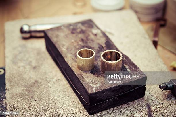 Two unfinished wedding rings in workshop of a goldsmith