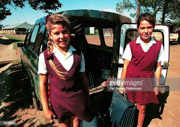 Two unidentified Afrikaner girls are picked up by their mother at a private school March 11 1997 in Venderstorp a conservative farming town 200...