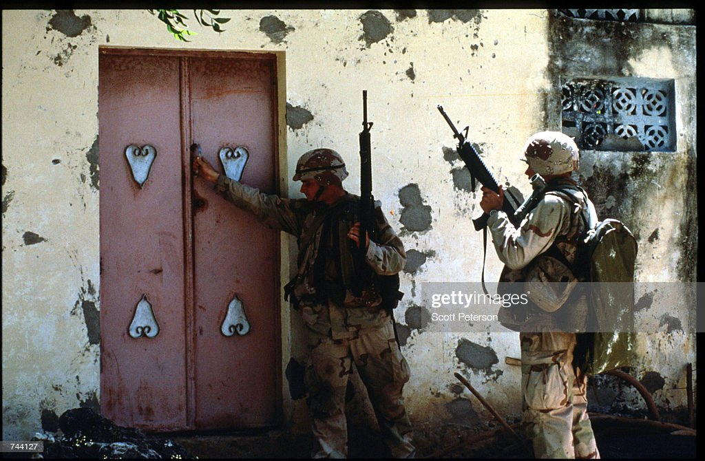 Two unidentified US soldiers patrol January 11 1993 in Mogadishu Somalia The United Nations hopes to restore order and save hundreds of thousands...