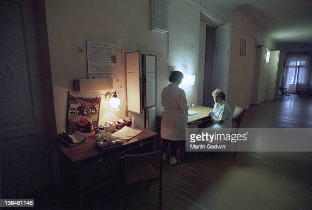 Two unknown nurses sitting outside the wards in Kiev's Hospital No 12 100km from Chernobyl November 1995