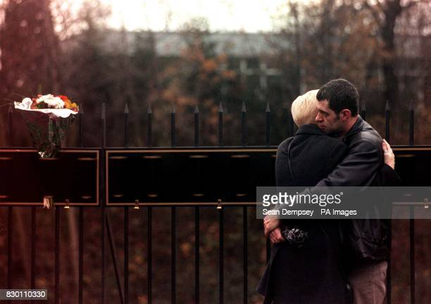 Two unnamed mourners embrace at the scene where about 50 mourners today commemorated the 10th anniversary of the most horrific rail crash in modern...