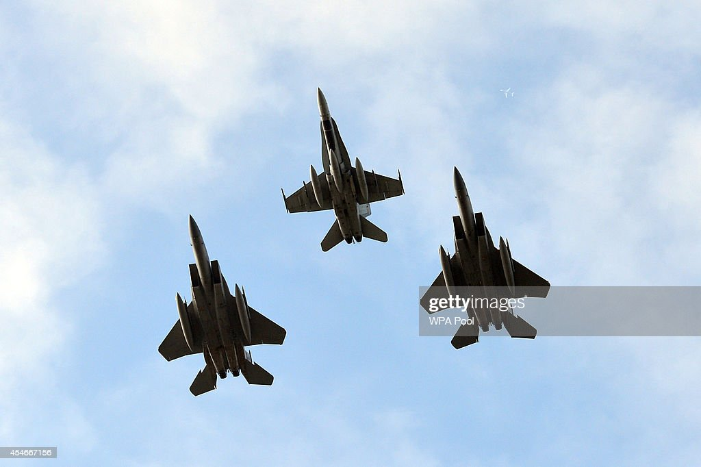 Two US F15C's and a Canadian F18 take part in a flypast over the NATO 2014 Summit at the Celtic Manor Resort the venue for the North Atlantic Treaty...