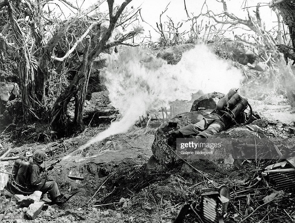 Two U.S. Marines direct flame throwers at Japanese defenses that block the way. 4th March 1945. On the left is Private Richard Klatt and on the right is Private First Class Wilfred Voegeli. Japan.