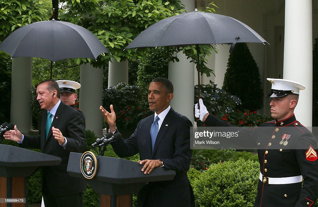 Two U.S. Marines hold umbrellas over U.S. President <a gi-track='captionPersonalityLinkClicked' href=/galleries/search?phrase=Barack+Obama&family=editorial&specificpeople=203260 ng-click='$event.stopPropagation()'>Barack Obama</a> (R) and Prime Minister <a gi-track='captionPersonalityLinkClicked' href=/galleries/search?phrase=Recep+Tayyip+Erdogan&family=editorial&specificpeople=213890 ng-click='$event.stopPropagation()'>Recep Tayyip Erdogan</a> of Turkey as they speak to the media in the Rose Garden at the White House May 16, 2013 in Washington, DC. The two leaders spoke about the fighting in Syria, and President Obama answered questions on the IRS Justice Department invesigation.