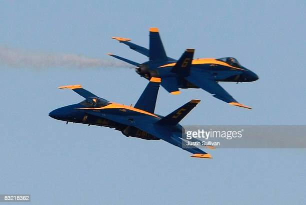 Two US Navy Blue Angels F/A18 Hornets execute a manuever as pilots practice their Fleet Week performance October 10 2008 in San Francisco San...