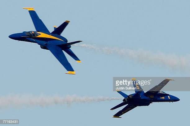Two US Navy Blue Angels F/A18 Hornets perform a stunt during a practice session for San Francisco Fleet Week October 4 2007 in San Francisco...