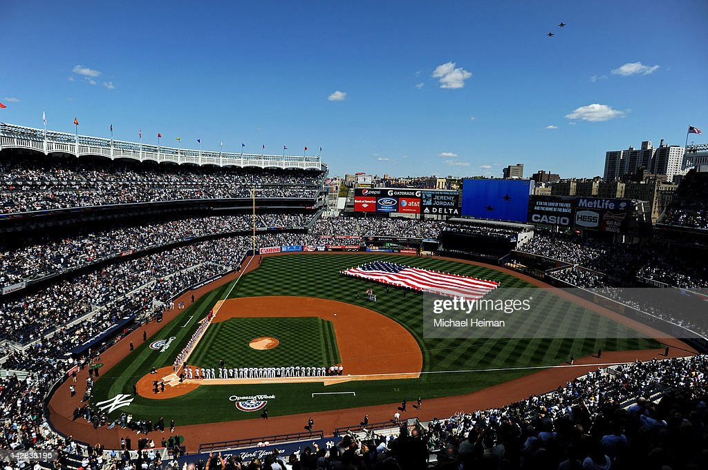 Two U.S. Navy F-18 Super Hornet Jets fly over Yankee Stadium as a giant American Flag is displayed prior to the New York Yankees home opener against the Los Angeles Angels on April 13, 2012 in the Bronx borough of New York City.