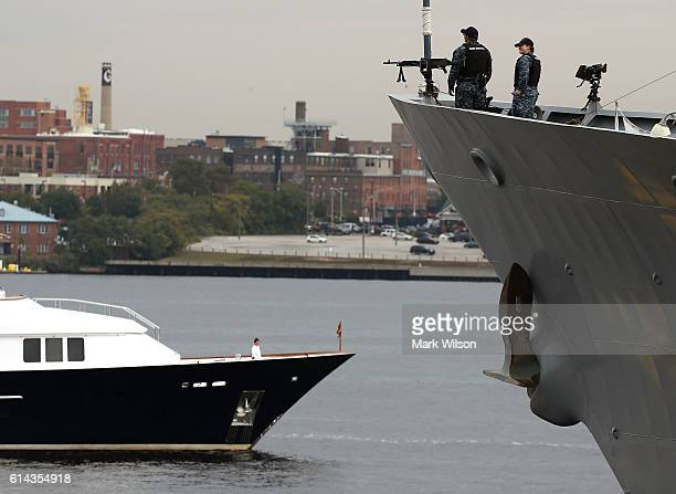 Two US Navy sailors stand on the bow of the USS Leyte Gulf that is moored to a dock in Baltimore Harbor on October 13 2016 in Baltimore Maryland This...