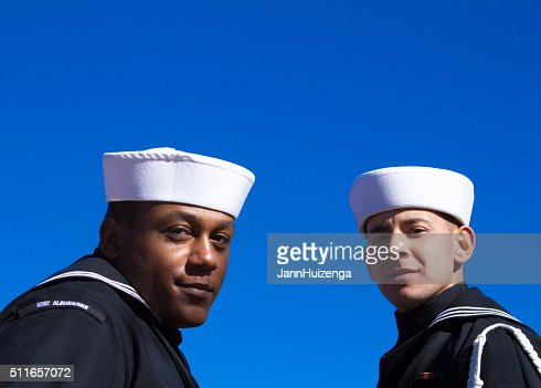 Two US Sailors at Veterans' Day Memorial Service, Blue Background