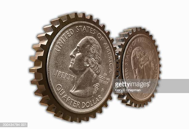 Two USA quarter dollar coins moving together as gears