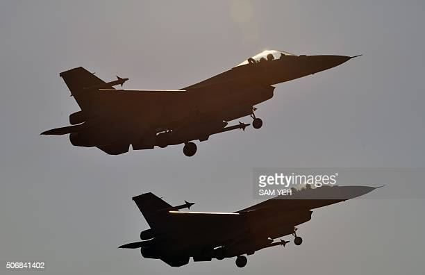 Two USmade F16 fighters take off from the Chiayi air force base in southern Taiwan during a demonstration on January 26 2016 International...