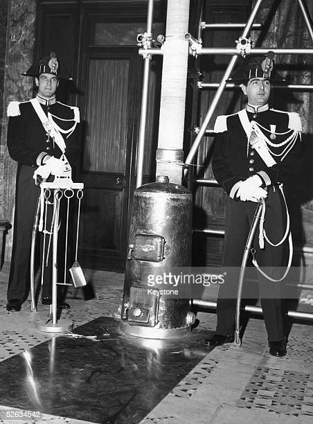 Two Vatican guards by the stove in which Catholic cardinals will burn their voting slips after electing a new Pope Vatican City 24th October 1958 The...