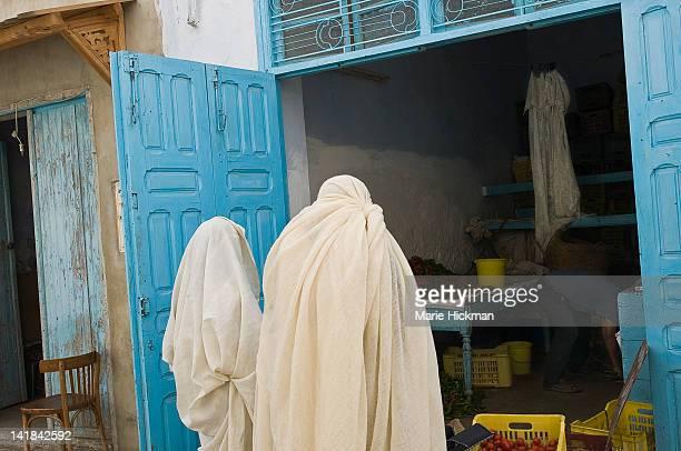 Two veiled women shopping in Kairouan, Tunisia