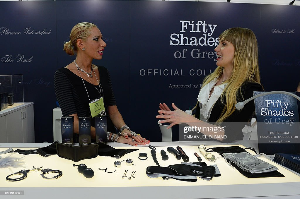 Two vendors talk to each other at the 'Fifty Shade of Grey' booth, the official pleasure collection inspired and approved by best seller author E.L. James by at CurveExpo New York, North America's leading designer lingerie trade show in New York, February 25, 2013. The biannual three-day trade show showcases leading lingerie designers in North America.