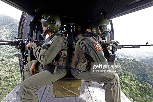 Two Venezuelan soldiers take part in an operation of destruction of clandestine cocaine laboratories located 2 km from the border with Colombia in...