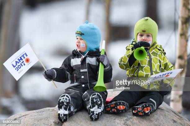 Two very young Finnish fans during Ladies crosscountry 30 km Mass Start Free final at FIS Nordic World Ski Championship 2017 in Lahti On Saturday...