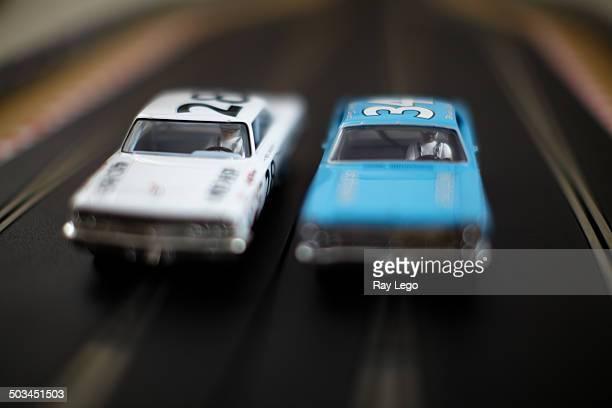 Two vintage Nascar slot cars racing.