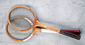 Two vintage tennis rackets on wooden background