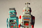 Two angry vintage tin toy robots, artificial intelligence, robotic drone delivery concept