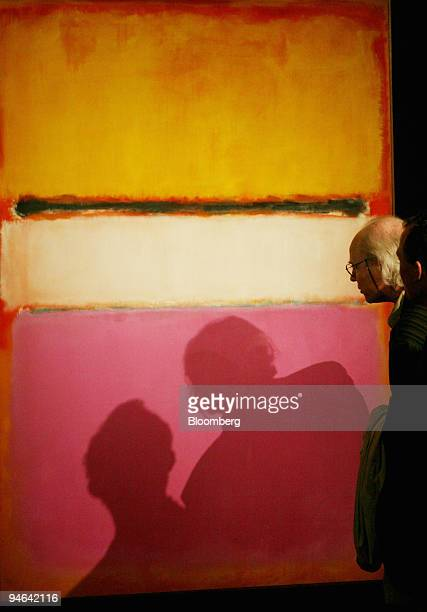 Two visitors look at a Mark Rothko painting from 1950 entitled ''White Center '' during a preview in London UK Wednesday April 18 2007 The painting...