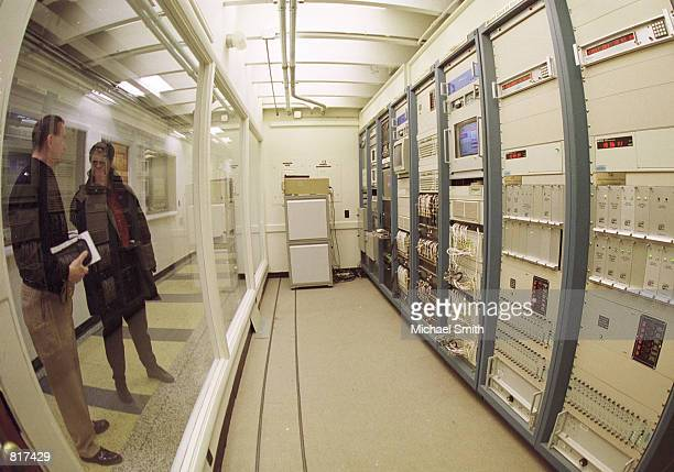 Two visitors look at the atomic clock timescale at the US Naval Observatory in Washington DC December 29 1999 By a Department of Defense directive...