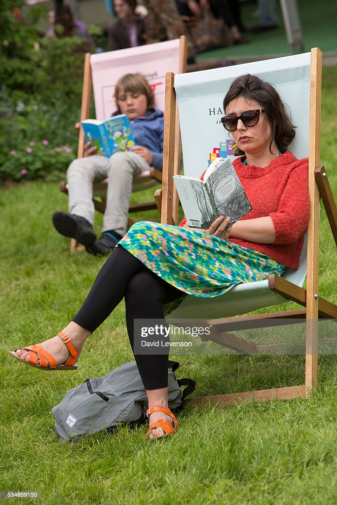 Two visitors read at the Hay Festival, on May 28, 2016 in Hay-on-Wye, Wales.