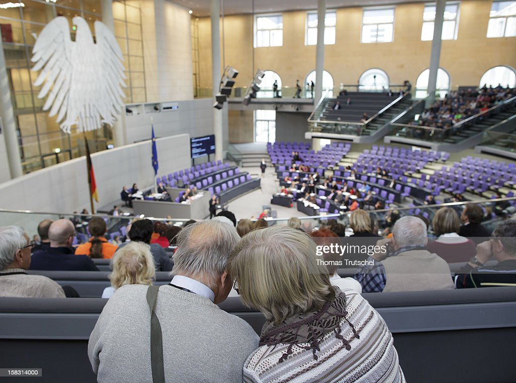 Two visitors talking at Reichstag, the seat of the German Parliament (Bundestag) on December 13, 2012 in Berlin, Germany.