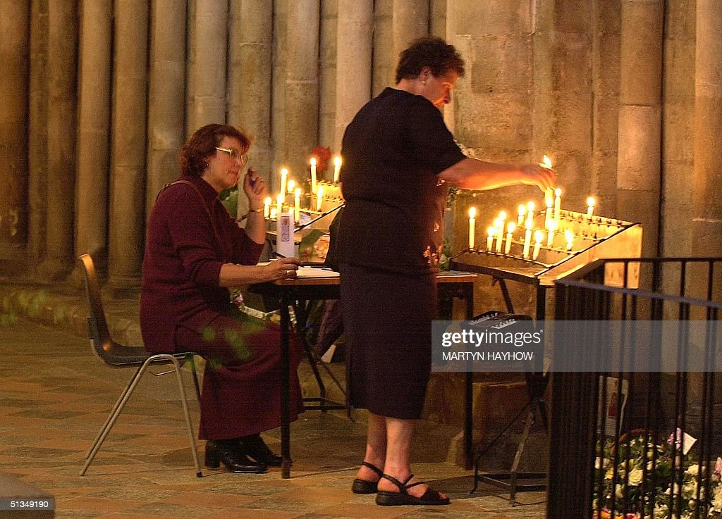 Two visitors to Ely Cathedral Cambridgeshire pay their respects 30 August 2002 prior to this afternoon's service of Celebration Rememberance of Holly...