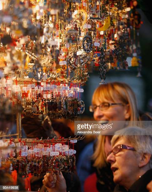 Two vistors inspect Christmas tree decorations during the opening day of the famous Christmas market on November 27 2009 in Nuremberg Germany