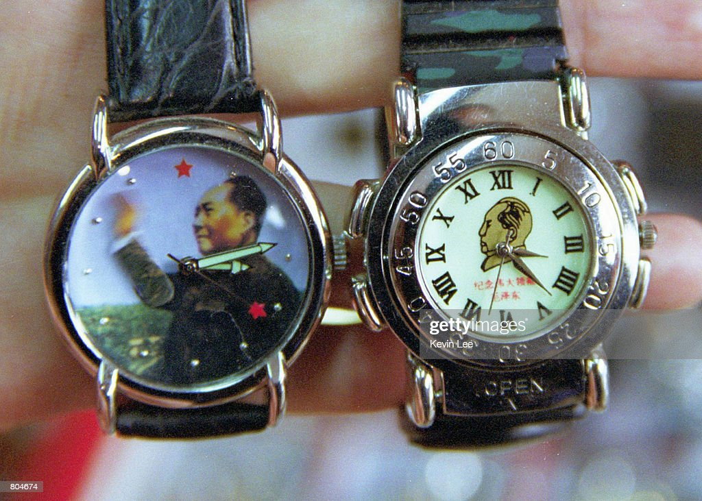 Two watches sporting Chairman Mao's portrait are on sale April 29, 2001 in the Forbidden City in Beijing. The watch on the left, with a movable arm, is sold for $8.00 and the one on the right is sold $3.00. Souvenirs with Mao's portrait can be found in parts of Beijing popular with foreign tourists.