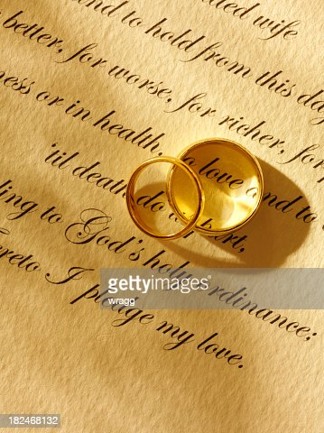 Two Wedding Rings and Traditional Marriage Vows : Stock Photo