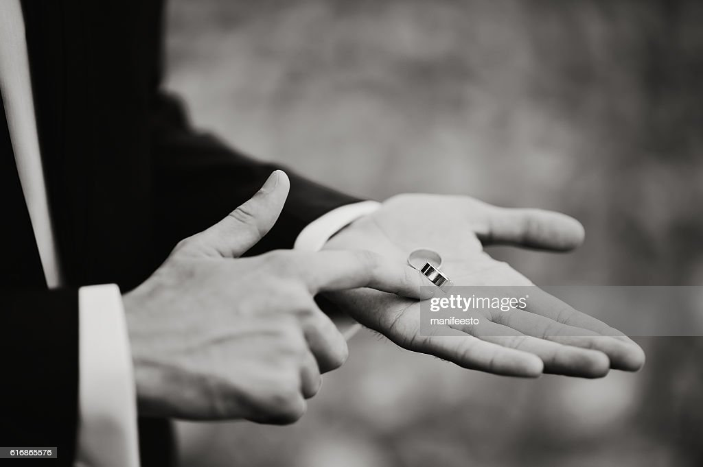two wedding rings on groom's palm : Stock Photo