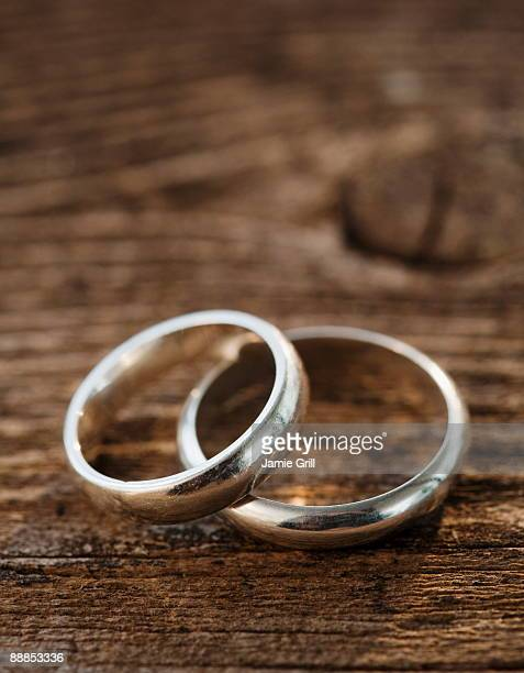 Two wedding rings on wooden table