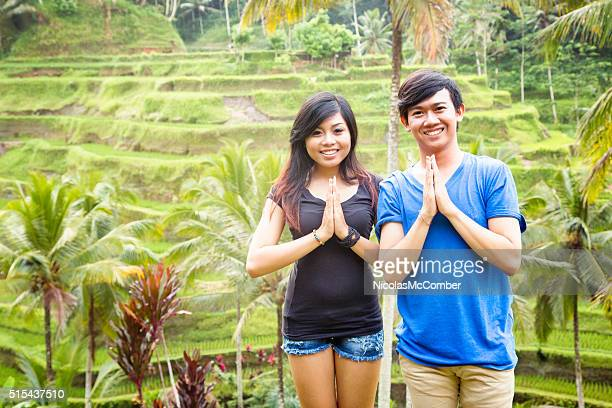 Two welcoming young Indonesian friends at rice paddy