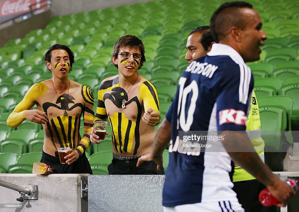 Two Wellington Phoenix fans try to talk to Archie Thompson of the Melbourne Victory after the round 15 A-League match between the Melbourne Victory and Wellington Phoenix at AAMI Park on January 5, 2013 in Melbourne, Australia.