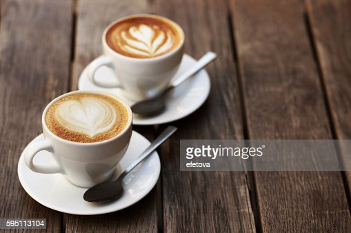 Two white cups of cappuccino : Stock Photo