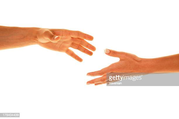 Two white people reaching their hands out to each other