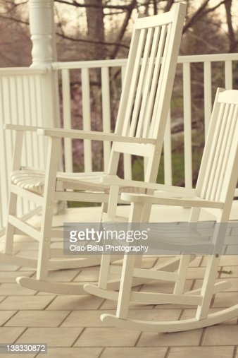 Two White Rocking Chairs On Porch Stock Photo  Getty Images