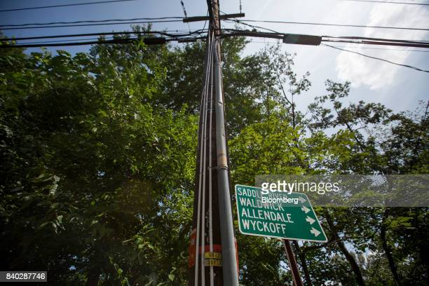Two white strips of 1inch conduit pipe denoting an eruv are seen a utility pole in Upper Saddle River New Jersey US on Sunday Aug 27 2017 It took...