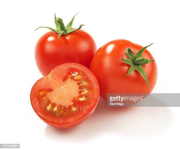 Two whole red ripe tomatoes and one in half