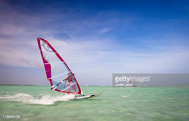 Two windsurfers.