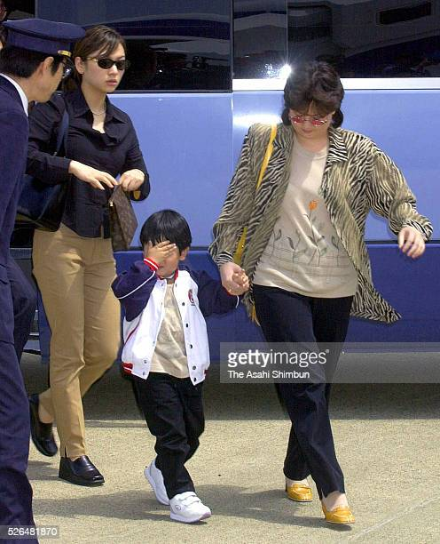 Two woman and a child accompanied with Kim JongNam are seen at New Tokyo International Airport on May 4 2001 in Narita Chiba Japan Kim Jong Nam was...