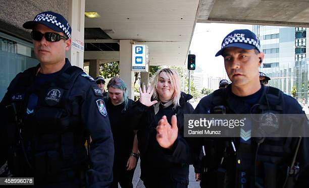 Two woman are detained for questioning during a protest against G20 leaders on November 15 2014 in Brisbane Australia World leaders have gathered in...