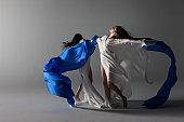 two woman draped in silk