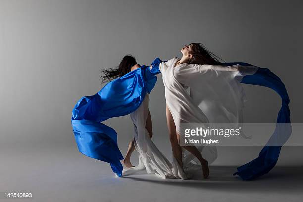 two woman draped in silk
